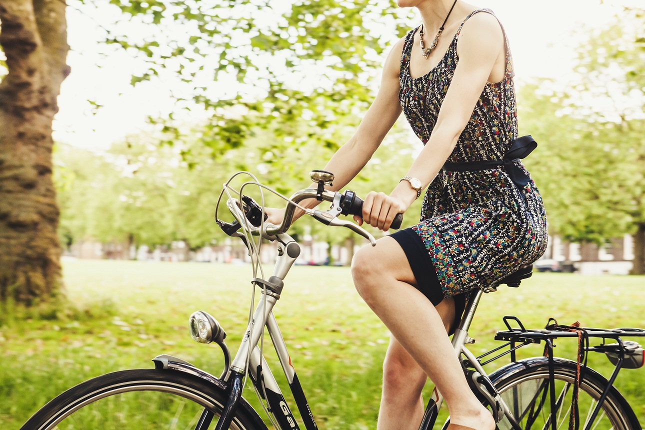 How can companies support sustainable travel options for employees?